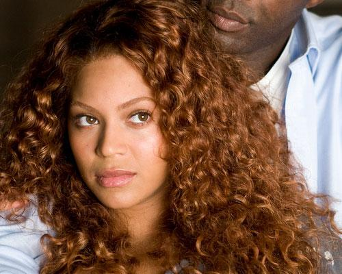 More Enticing Her Light Brown Curly Hair Let Loose Shoulders